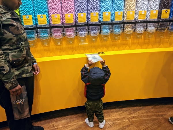 Baby grabbing bag at M&M World in Las Vegas