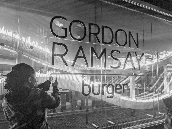 Outside Gordon Ramsey Burger in Las Vegas with a baby
