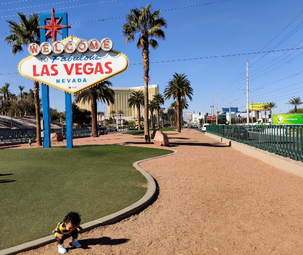 Wekcome to Las Vegas sign with toddler