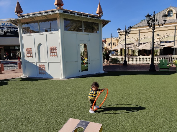 toddler playing with hula hoop Towne Square Park Las Vegas