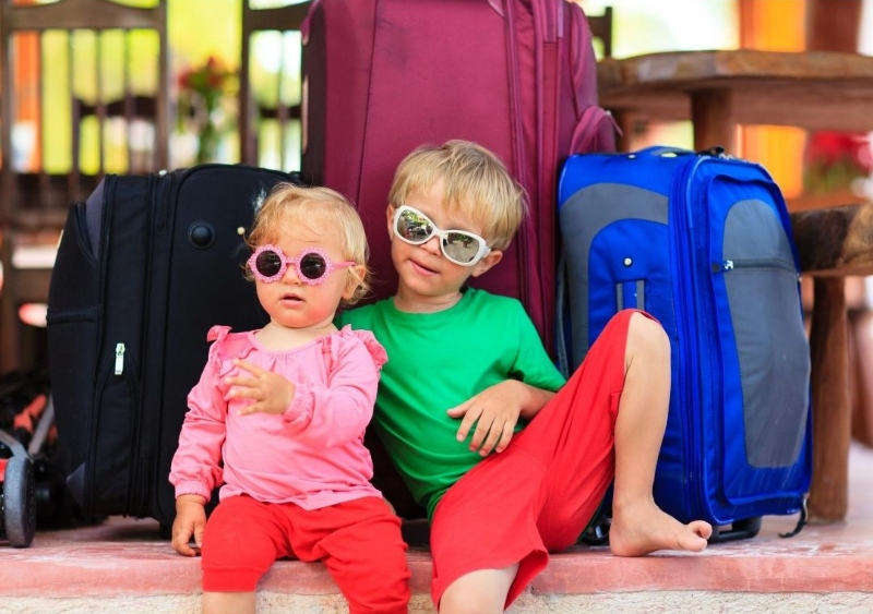 baby and toddler with luggage
