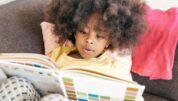 Toddler reading a travel book