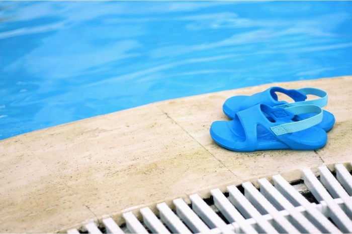 Toddler water shoes near a pool