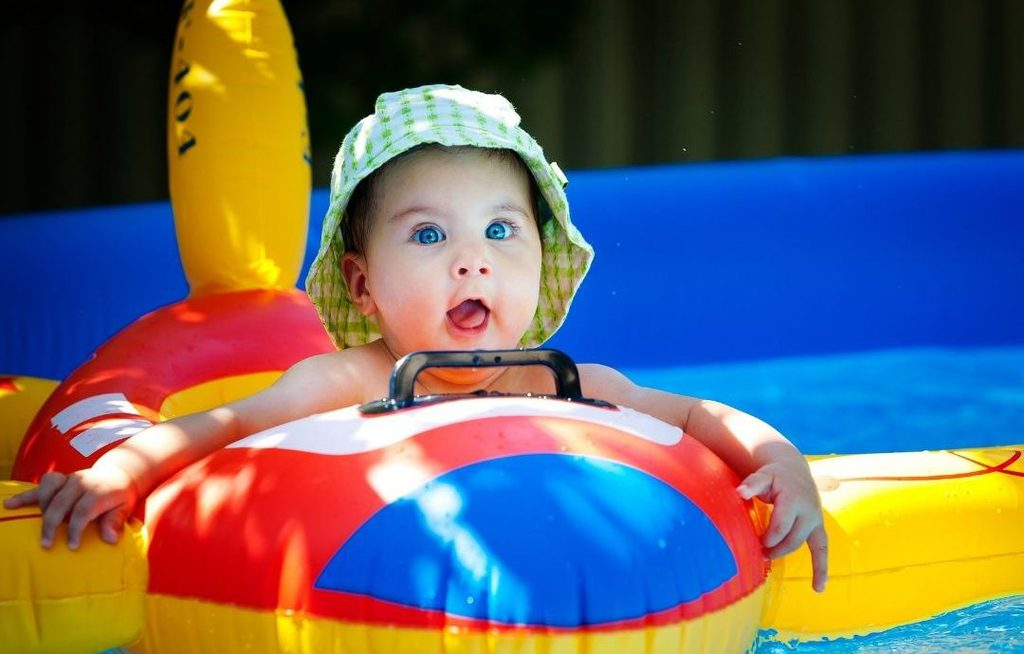 baby in swim float