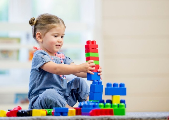 Toddler with different color Lego Alternatives