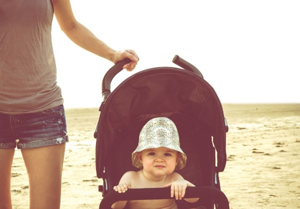 Baby in a stroller at the beach