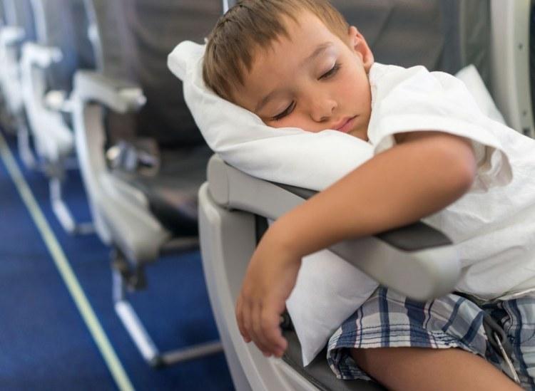 kid sleeping on travel pillow