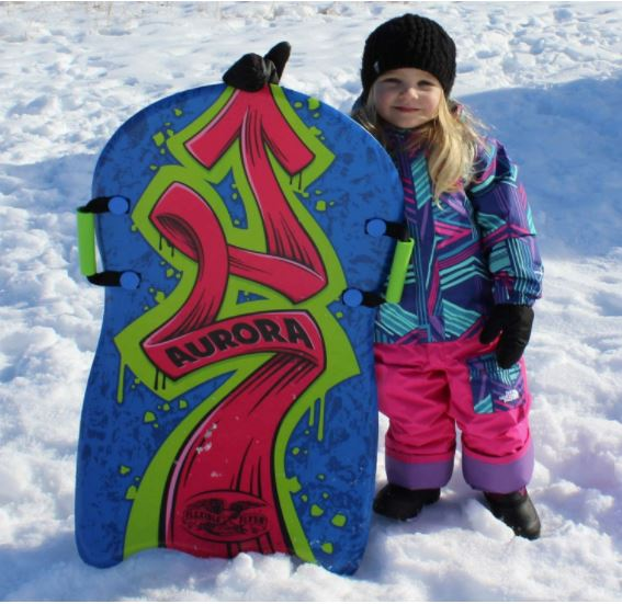 toddler with a snow sled